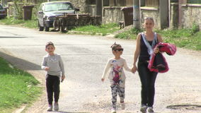 Mother with children in Bulgaria. Mountain village Anton - Bulgarian center of rural tourism, national rural architecture and a popular tourist route stock video footage