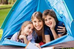 Mother With Children Camping In Park Stock Photos