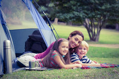 Mother and children camping in the park Stock Photos