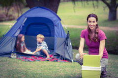Mother and children camping in the park Royalty Free Stock Photos