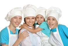 Mother and children in chef uniforms Stock Photography