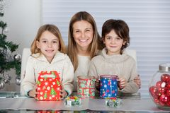 Mother And Children With Christmas Presents Royalty Free Stock Images