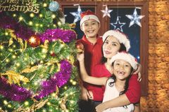 Mother and children with Christmas tree at home Royalty Free Stock Photos