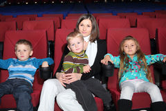 Mother with children in the cinema Royalty Free Stock Images
