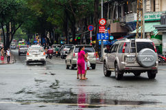 Mother and children crossing the street in Ho Chi Minh City, Vietnam Stock Photo