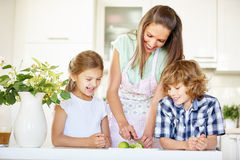 Mother and children cutting lime fruits stock photo