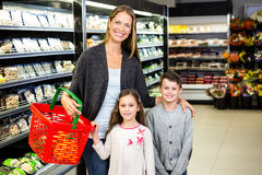 Mother and children doing grocery shopping Stock Photos