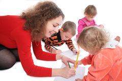Mother with children drawing Royalty Free Stock Photography