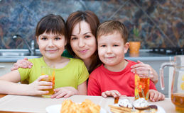 Mother with children drink juice royalty free stock images