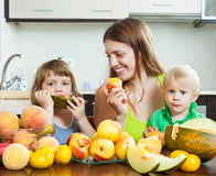 Mother with children eating fruits royalty free stock image