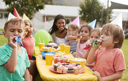 Mother With Children Enjoying Outdoor Birthday Party Together Royalty Free Stock Photo