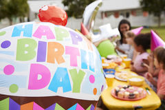 Mother With Children Enjoying Outdoor Birthday Party Together Stock Photos