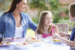Mother And Children Enjoying Outdoor Meal Together Royalty Free Stock Photography