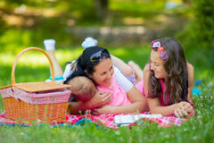Mother with children enjoying at the picnic Royalty Free Stock Photo