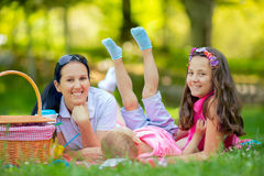 Mother with children enjoying at the picnic Stock Image