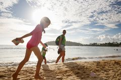 Mother with children enjoying a tropical beach hike royalty free stock photo
