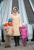 Mother and children at escalator Royalty Free Stock Images