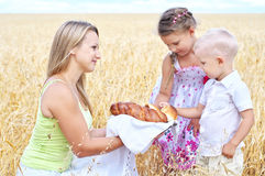 Mother with children on a field of wheat Stock Image