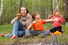 Mother and children finish to eat shish kebab Royalty Free Stock Images