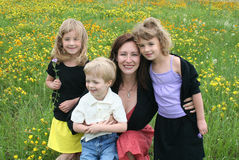 Mother and Children in Flower Field Royalty Free Stock Photos