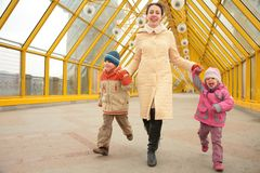 Mother with children on footbridge royalty free stock images