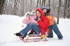 Mother and children in forest at winter Stock Photo