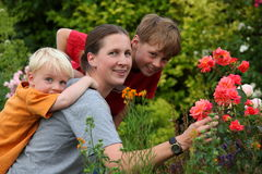 Mother with children in the garden Stock Photos