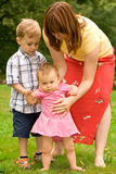 Mother and children in garden Stock Image