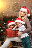 Mother and children with gifts Stock Photos