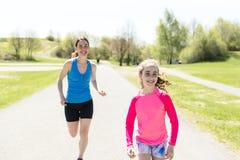 Mother with children girl sport running together outside. A mother with children girl sport running together outside stock photos