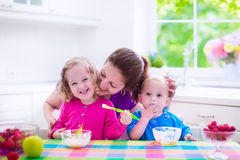 Mother and children having breakfast Royalty Free Stock Images