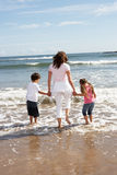 Mother And Children Having Fun On Beach Holiday Stock Photos