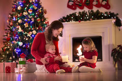 Mother and children at home on Christmas eve Royalty Free Stock Photography