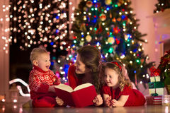 Mother and children at home on Christmas eve Royalty Free Stock Images