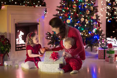 Mother and children at home on Christmas eve Stock Image