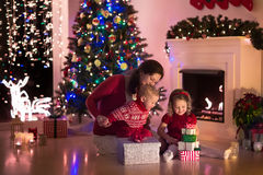Mother and children at home on Christmas eve Royalty Free Stock Photos