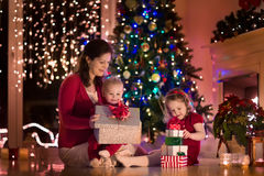 Mother and children at home on Christmas eve Royalty Free Stock Image