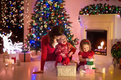 Mother and children at home on Christmas eve Stock Photography