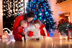Mother and children at home on Christmas eve Stock Images