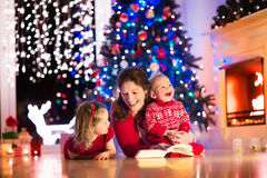 Mother and children at home on Christmas eve Stock Photo