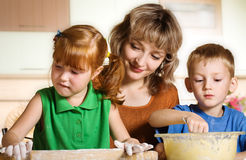 Mother with children in kitchen Stock Photo