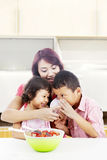 Mother and children in kitchen Royalty Free Stock Image