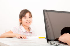 Mother and children with a laptop at home. A mother with her kids with at a laptop at home Royalty Free Stock Photos