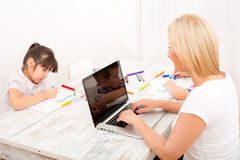 Mother and children with a laptop at home Royalty Free Stock Photo
