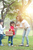 Mother and children lifestyle in nature park. Royalty Free Stock Photo