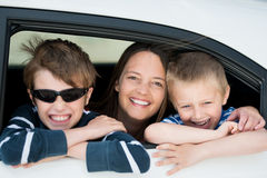 Mother and children. Looking out the car window in a happy portrait stock image