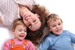 Mother and children lying Stock Images