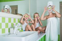 Mother and children make a face mask in the morning.Beauty treatments for the skin. Beauty treatments for the skin.Mother and children make a face mask in the stock image