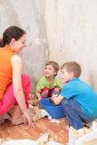 Mother with children makes room renovations Stock Image