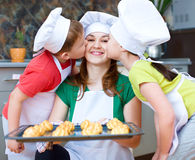 Mother with children making bread royalty free stock photography